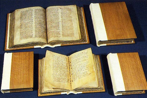 Great and Little Domesday Books today bound in five parts: two (above) for Great Domesday and three (below) for Little Domesday; Catalogue reference: E 31/2/1-2 and  E 31/1/1-3