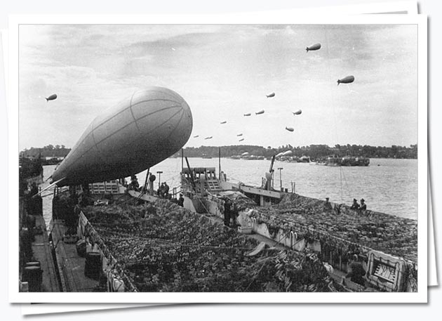 Landing craft with balloon sets off for Normandy; DEF 2/502