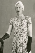 Police photograph of Dudley Clarke dressed as a woman
