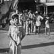 Traffic and pedestrians in Calcutta, photographed by Cecil Beaton (INF 14/432)