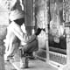 Workman renovating paintings at the city palace, Jaipur, photographed Cecil Beaton (INF 14/443)