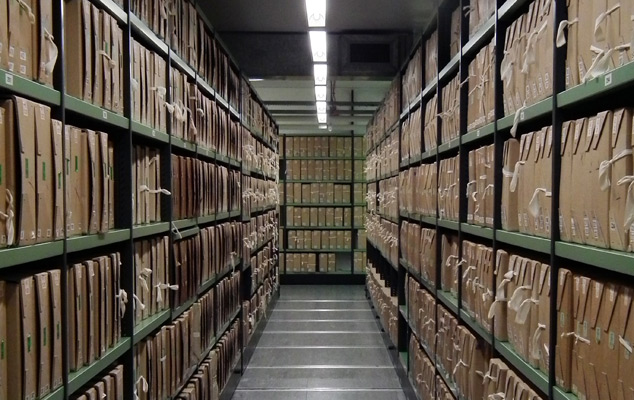 Document stacks in a repository at The National Archives