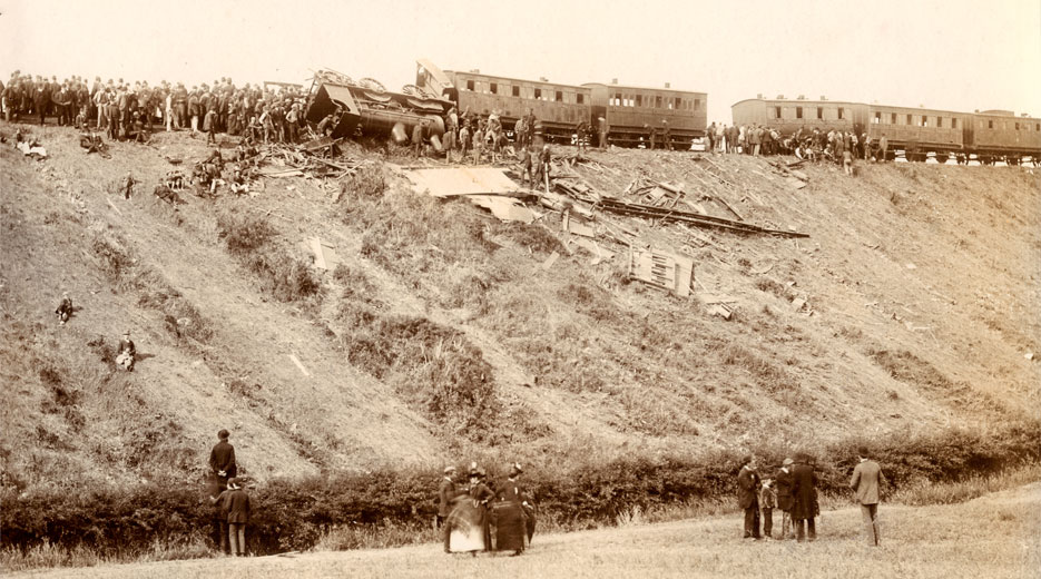 Photograph of Armagh rail disaster crash site, clearly showing the carriages that rolled backwards and the locomotive they collided with