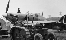 Photograph of WAAFs refuelling a Hawker Hurricane. These aircraft were used during the Second World War  (catalogue reference: INF 2/42/93)
