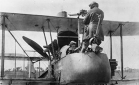 Photograph of RFC airmen with biplane (Catalogue reference: AIR 1/169/15/160/5)