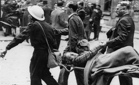 Photograph of home guard helping injured in V1 bomb attack at Aldwych, London, 1944 (Catalogue reference: AIR 20/6185)