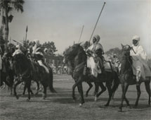 A display of Adamawa Horsemen in honour of Visiting Mission at Yola (1955). - Catalogue reference: CO 1069/24